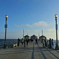Photo taken at Huntington Beach Pier by Alex M. on 4/22/2013