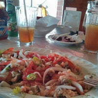Photo taken at Pescaderia el sabroso by Yiner C. on 8/1/2014