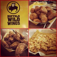 Photo taken at Buffalo Wild Wings by Renz N. on 6/9/2013