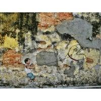 Photo taken at Penang Street Art : Little Boy with Pet Dinosaur by Arif Y. on 12/30/2013