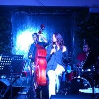 Photo taken at The Ritz-Carlton Bleu Lounge & Grill by Ozan Y. on 9/26/2012