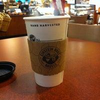 Photo taken at Einstein Bros Bagels by Scott P. on 10/31/2012