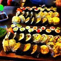 Photo taken at Sushi Garden by Cristi on 12/1/2013