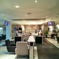 Photo taken at Golden Falcon Lounge by Redha A. on 8/1/2014