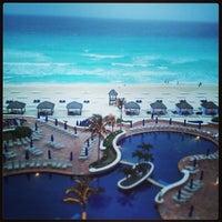 Photo taken at The Ritz-Carlton, Cancun by Ashley M. on 4/13/2013