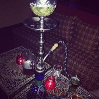 Photo taken at Cozy Cafe Hookah Lounge by Ernesto T. on 7/4/2014