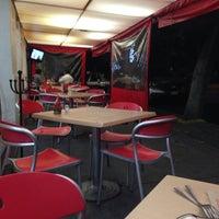 Photo taken at El Farolito by Clau on 3/21/2014