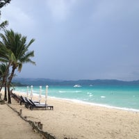 Photo taken at White Beach by Roussel on 10/1/2012