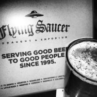 Photo taken at Flying Saucer Draught Emporium by Cat R. on 5/17/2013