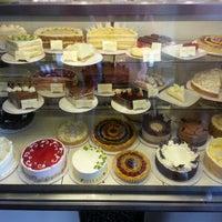Photo taken at Pastiche Fine Desserts & Café by Clara S. on 4/16/2013
