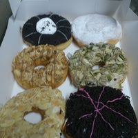Photo taken at Big Apple Donuts & Coffee by Darren C. on 7/17/2014