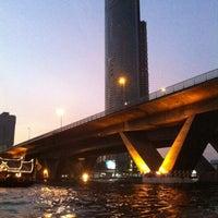 Photo taken at King Taksin Bridge by DRair W. on 4/10/2013