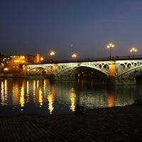 Photo taken at Isabel II Bridge 'Triana Bridge' by Azhar M. on 12/6/2012