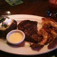 Photo taken at Outback Steakhouse by Rebecca T. on 1/31/2011