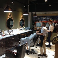 Photo taken at QOD Barber Shop by Alexandre T. on 3/23/2015