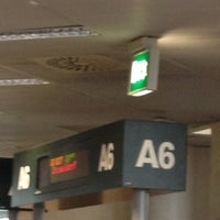 Photo taken at Gate A06 by Christian on 4/22/2013