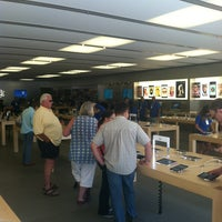 Photo taken at Apple University Village by Grant G. on 7/21/2013