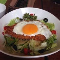 Photo taken at Jugar cafe by tokitsu on 6/5/2014