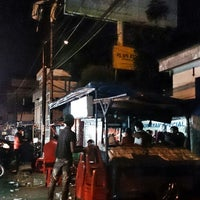 Photo taken at Bubur Ayam Special BEJO by Dion D. on 10/2/2014