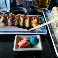 Photo taken at Blue Wasabi Sushi & Martini Bar by Jonathan N. on 7/25/2014