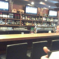 Photo taken at The Noble Pig Brewhouse & Restaurant by Calvin Q. on 5/18/2014