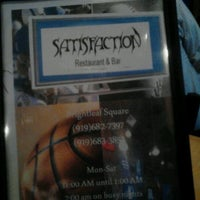 Photo taken at Satisfaction Restaurant & Bar by Shelton S. on 1/31/2013