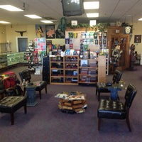 Photo taken at DJ's Smoke Shop by Philip B. on 10/6/2013