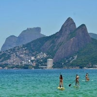 Photo taken at Ipanema Beach by Marko K. on 7/27/2013