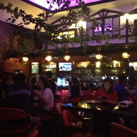 Photo taken at Euros Bar & Dine by Ping on 5/20/2013