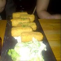 Foto tomada en Saffron Restaurant & Tapas por Mac R. el 1/11/2013