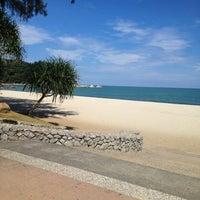 Photo taken at Pantai Teluk Cempedak (Beach) by Salmonella on 11/20/2012