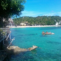 Photo taken at Diniwid Beach by Polina V. on 4/28/2013