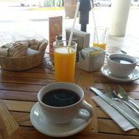Photo taken at Bartola Restaurant € Coffee Bar by Emmanuel N. on 1/28/2013
