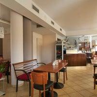 Photo taken at Café Spago by Dawe K. on 10/27/2012