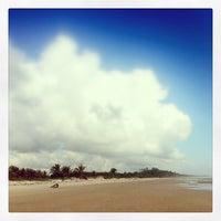 Photo taken at Praia da Costa by Crisinha on 1/2/2014
