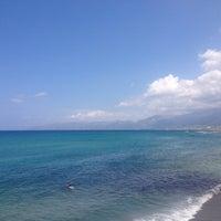 Photo taken at Пляж Aldemar Knossos by Polina K. on 7/7/2013