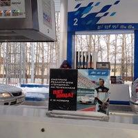 Photo taken at Газпромнефть АЗС № 21 by Ekaterina G. on 11/29/2014