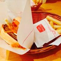 Photo taken at MOS Burger by Sarah on 12/9/2013