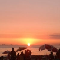 Photo taken at Pôr do Sol em Camboinhas by Michela M. on 1/27/2014