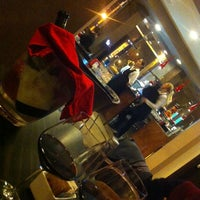 Photo taken at Mio Caffe by Raluca M. on 2/7/2014