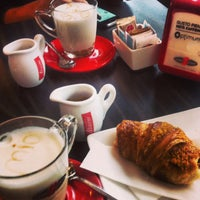 Photo taken at Mio Caffe by Raluca M. on 2/9/2014