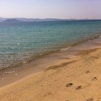 Photo taken at Plaka Beach by Katerina O. on 5/4/2013