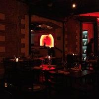 Photo taken at Mamajuana Cafe by Danny on 10/13/2012