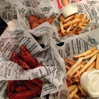 Photo taken at Wingstop by Tina C. on 10/19/2013
