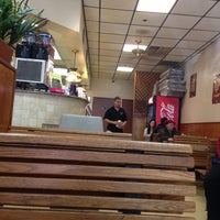 Photo taken at Neil's Pizzeria by PapiCaine M. on 11/29/2012