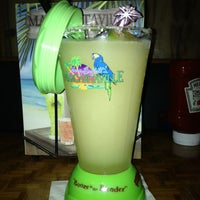 Photo taken at Jimmy Buffet's Margaritaville by Molly P. on 3/7/2012