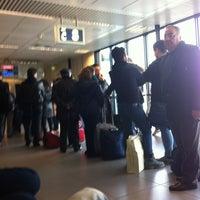 Photo taken at Gate C2 by Antonietta A. on 1/4/2013
