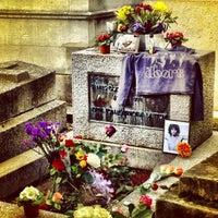 Photo taken at Tombe de Jim Morrison by Sandrine A. on 3/17/2013