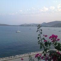 Photo taken at Portofino Hotel & Beach by Bekir on 8/17/2013