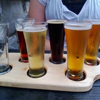 Photo taken at Latitude 42 Brewing Company by Dustin T. on 8/6/2013